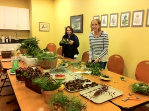 Guests participating in Jessie's decorating with nature class.  Look at the plethora of options!